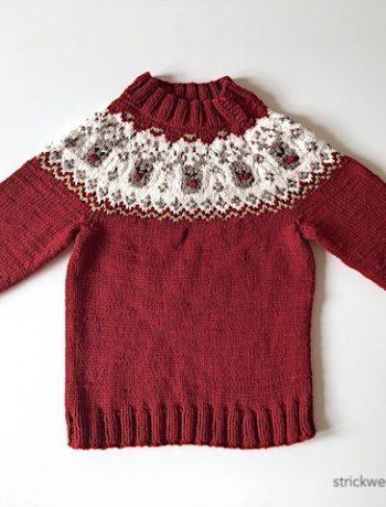 roter Pullover mit Rentieren
